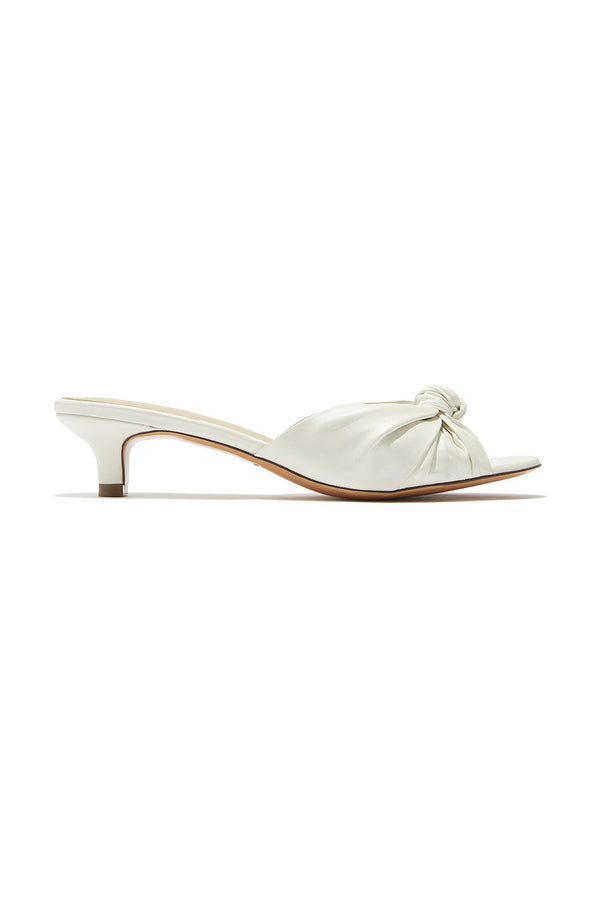 Low heeled white leather knotted Jeanne sandals by Mari Giudicelli