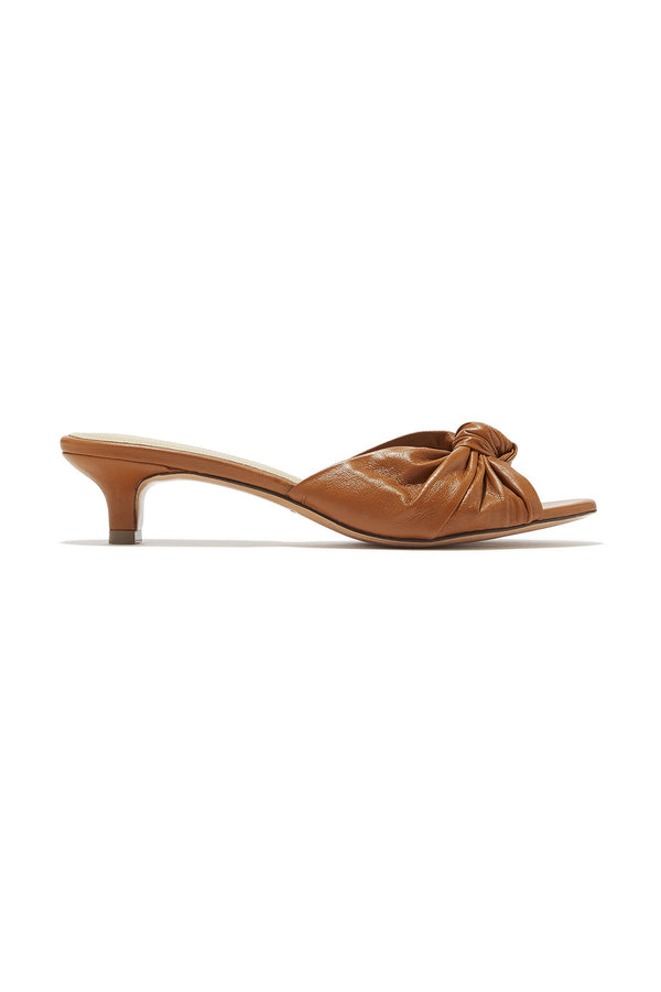 Low heeled brown leather knotted Jeanne sandals by Mari Giudicelli