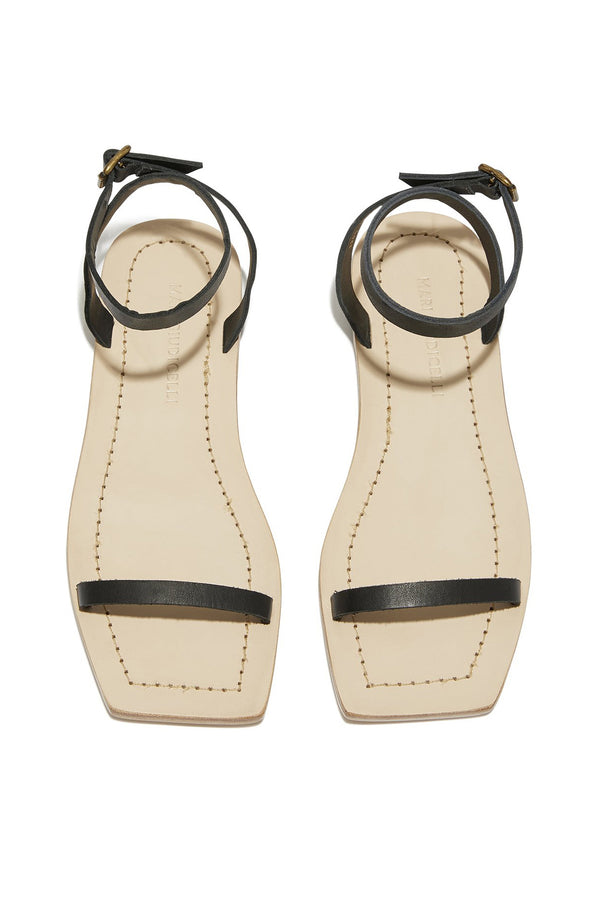 Black leather strap Valencia flat sandals by Mari Giudicelli