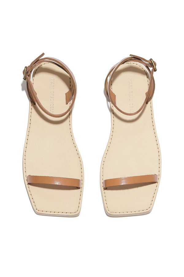 Tan leather strap Valencia flat sandals by Mari Giudicelli