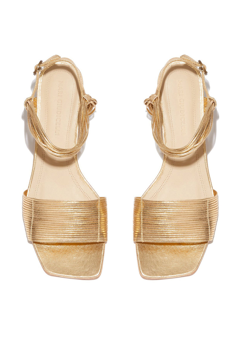 Heeled gold leather Vitta sandal by Mari Guidicelli