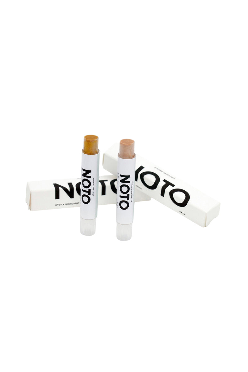The NOTO Glow Duo including Hydra Highlighter stick and Gold Glow stick by NOTO Botanics