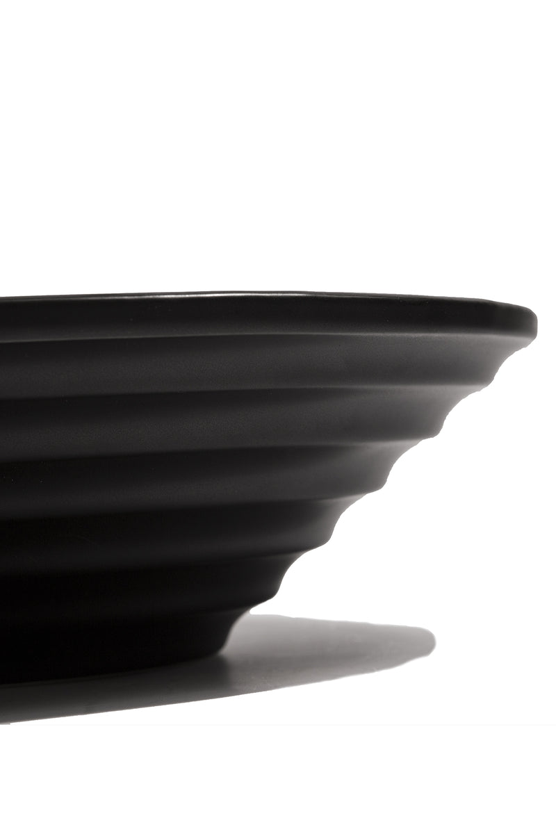 Black porcelain ceramic display bowl from Sesstra