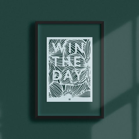 Win the Day laser cut wall art in light blue card in black frame