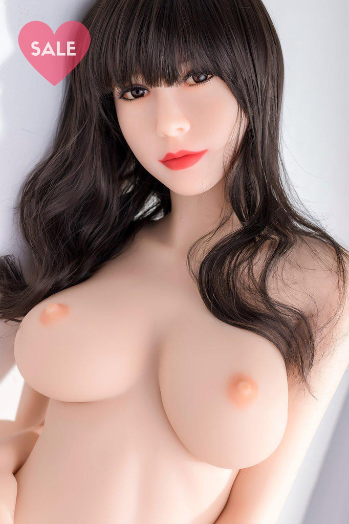 Cindy, a realistic sex doll by WM-Dolls with long brown hair & fully naked.
