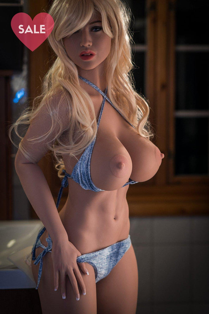 Brandi, a realistic sex doll by WM-Dolls, showing her breasts.