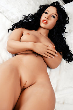 Tammy, a realistic sex doll by WM-Dolls with long black hair, naked on a bed.