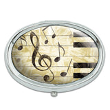 Vintage Piano with Treble Clef and Music Notes Metal Oval Pill Case Box