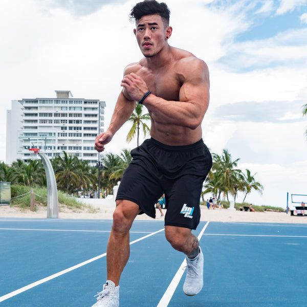 athlete running in black gym shorts