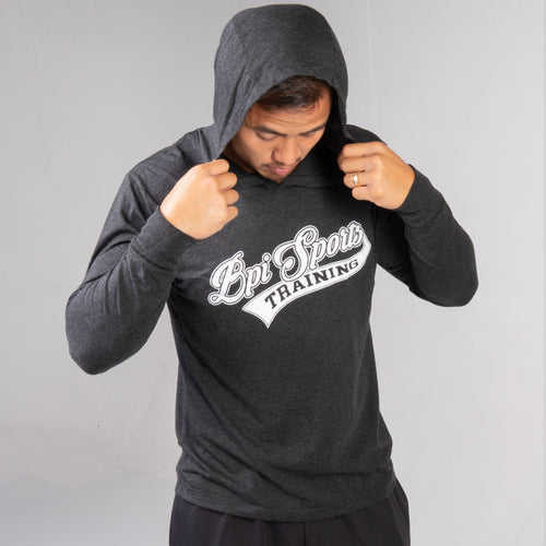 man wearing the BPI Sports Training Long-Sleeve Hoodie with the hood up