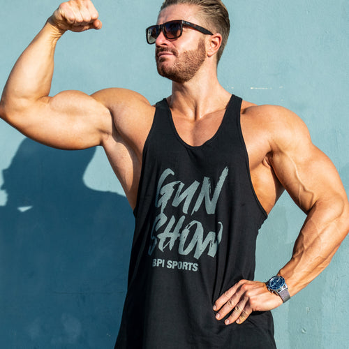 Athlete flexing his bicep in the BPI Sports Gun Show Stringer tank