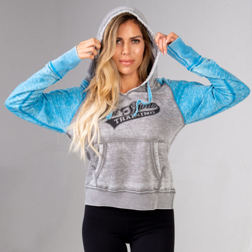 Woman wearing the Ladies BPI Sports Training Pullover Hoodie with hood up