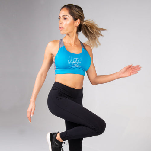 Woman running and working out in the BPI Sports Women's Sports Bra