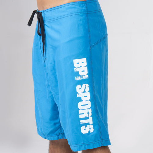 Side view of man wearing BPI Sports Swim Trunks in blue