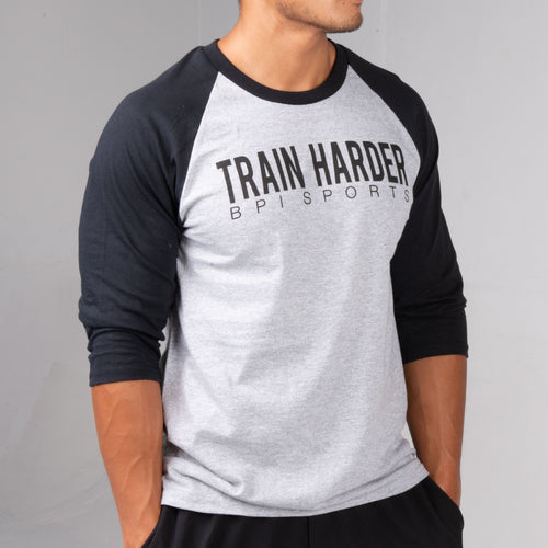Side profile of man wearing the BPI Sports Train Harder Baseball Unisex Shirt