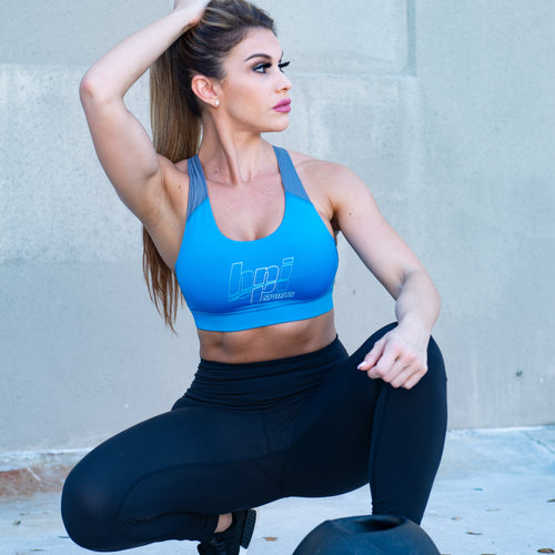 Woman squatting in BPI Sports Women's Sports Bra and black leggings