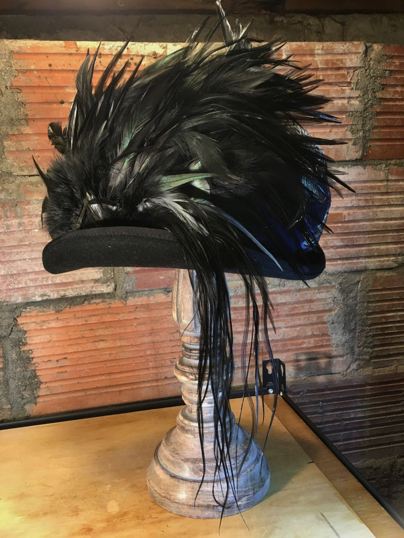 Wearable art handcrafted one feather at a time.