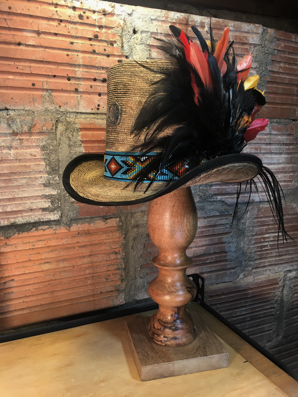 Feather embellishments are done one feather at a time.  Get your color on with this top hat.