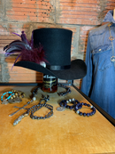 The large sterling silver conch is perfect with the feathers! Make a statement with this top hat!