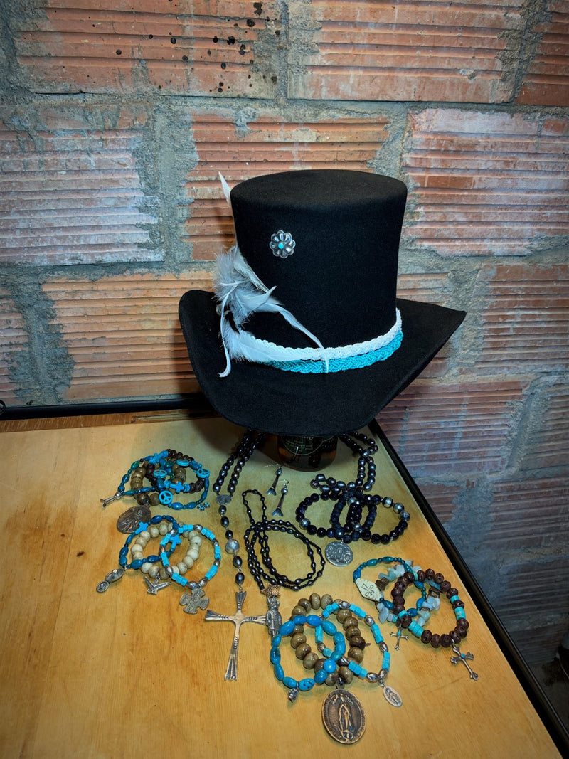 Beads, feathers, sterling silver....OH MY! Handcrafted, wearable art all in one top hat.