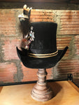 Sterling silver and turquoise Thunderbird helps make the statement. Adorned with Dusty's signature feather embellishment, this top hat is a piece of art.