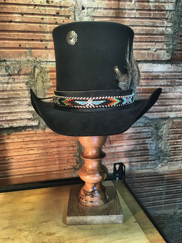 Just like the Phoenix rises from the ashes to be re-born, this 1950's beaded belt has been revived as a hat band.