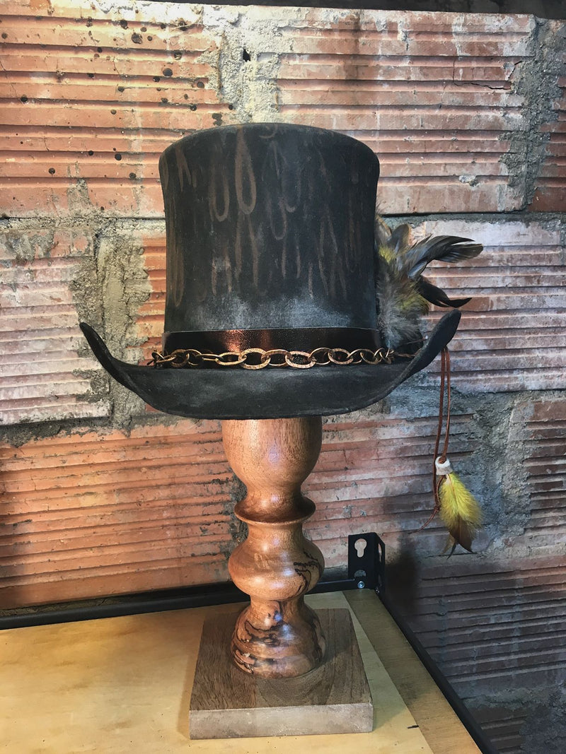 The metallic leather hat band and copper chain shine! This hat is highly distressed and will fit into your collection like it's been there for years!