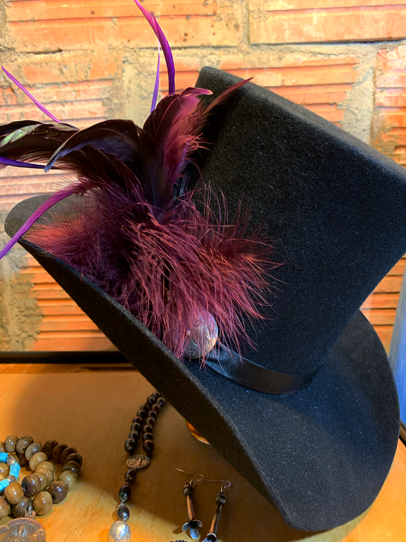Take a walk on the wild side in the Purple Haze top hat! The perfect accessory!