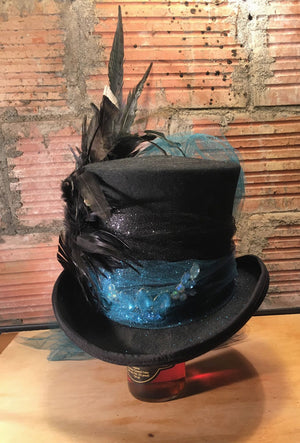 I love to use vintage costume jewelry to create style and character.  This top hat may be our standard base but everything about it is custom and will not be seen again.