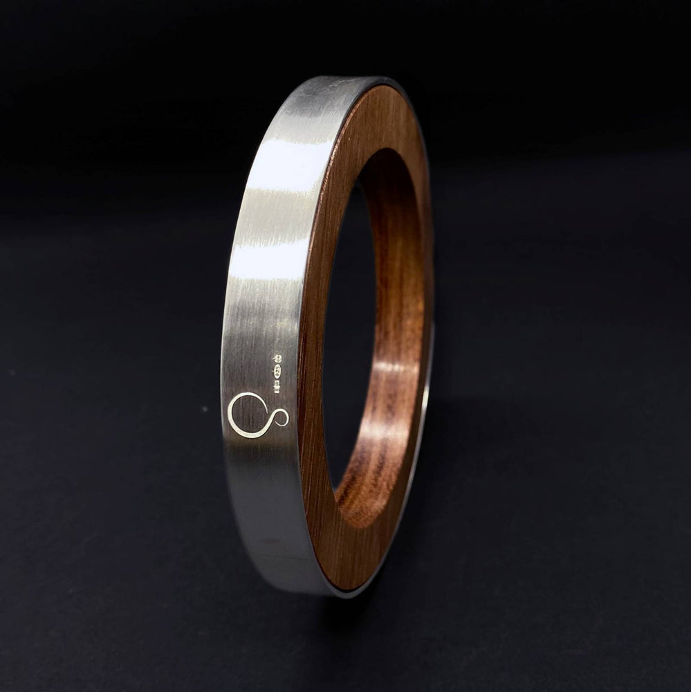Silverwood Jewellery logo and hallmark on the Iris silver and wood statement vegan bangle handcrafted