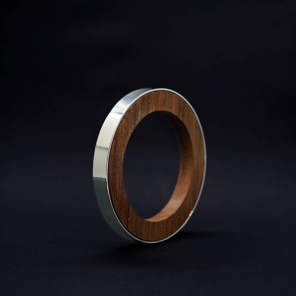 Iris Circle Bangle by Silverwood Jewellery with wood inner vegan polish and sterling silver bangle
