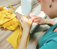 Students sewing upcycle garments