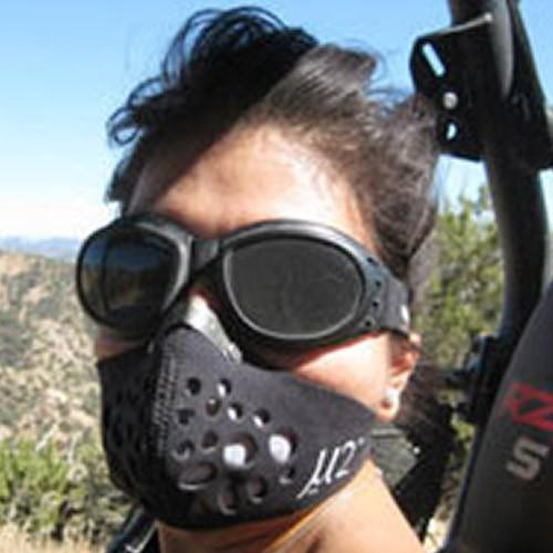 Girl off roading wearing U2 Mask