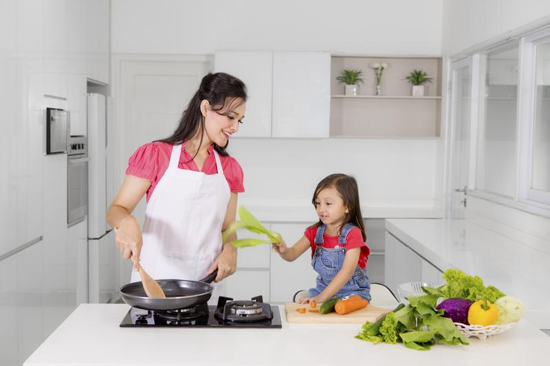 Mother and Child Cooking in Kitchen with Vegetables