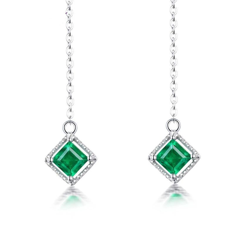 Elegant 0.6 Ct deep green Emerald dangle-earrings with 18k white gold