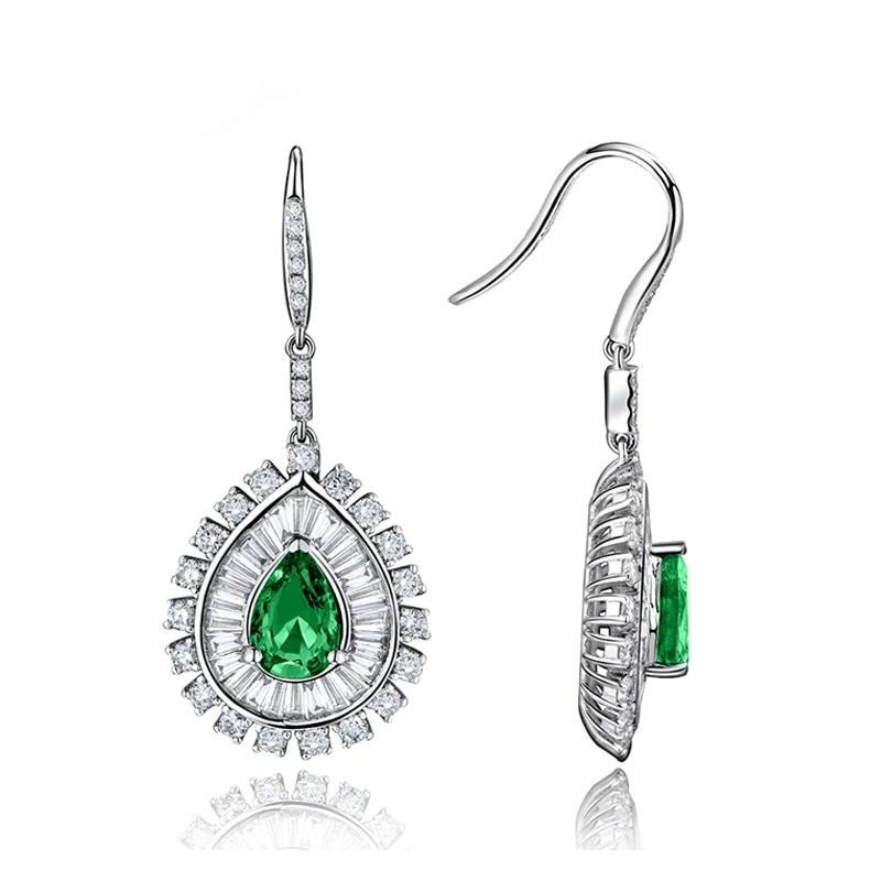 2.2 Ct deep green Emerald fish hook-earrings with 18k white gold & diamond