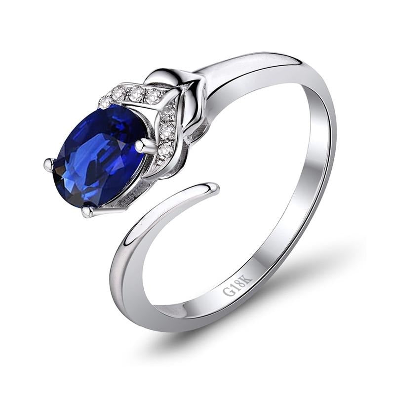 0.9 Ct deep blue Sapphire prong-setting ring with 18k white gold & diamond