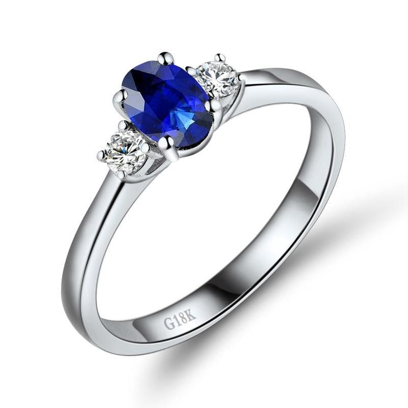 0.55 Ct deep blue Sapphire prong-setting ring with 18k white gold & diamond