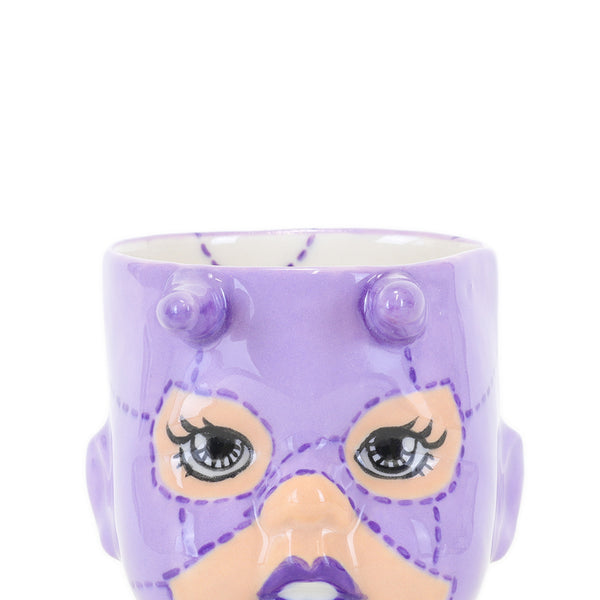 Cece the purple devil doll cup front closeup