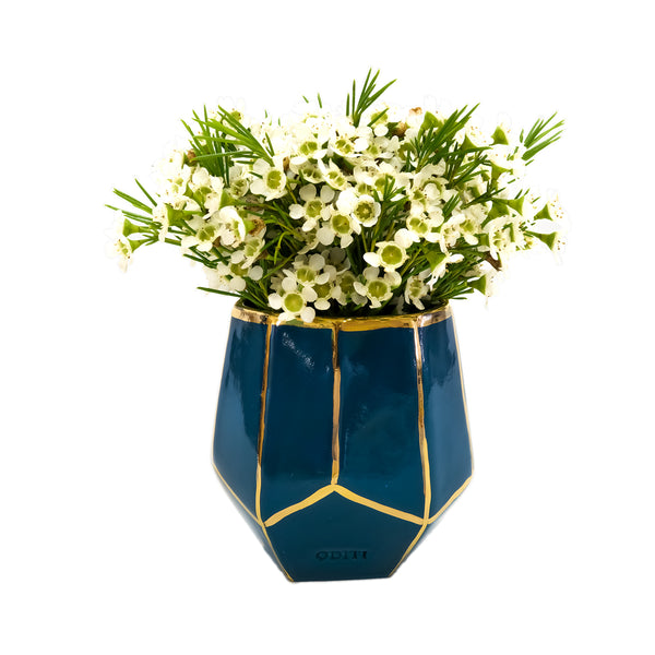 Oditi Designs geometric blue green vase with flowers
