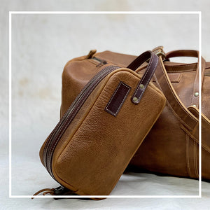 Tan leather toiletry Dopp kit
