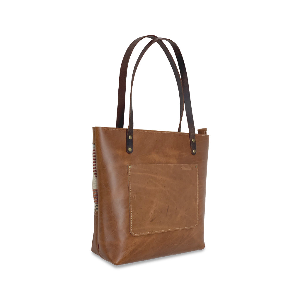 brown leather and canvas tote bags