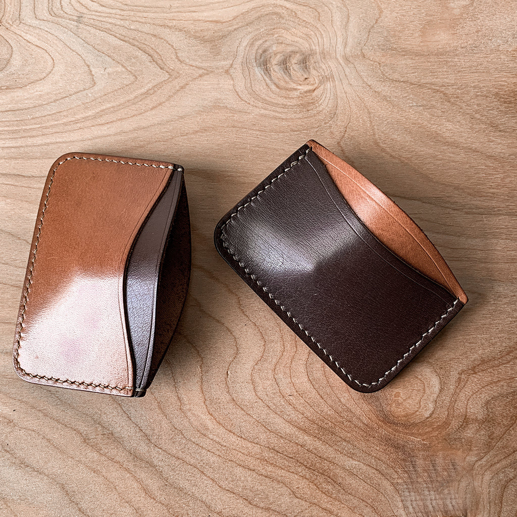brown and tan leather card holder