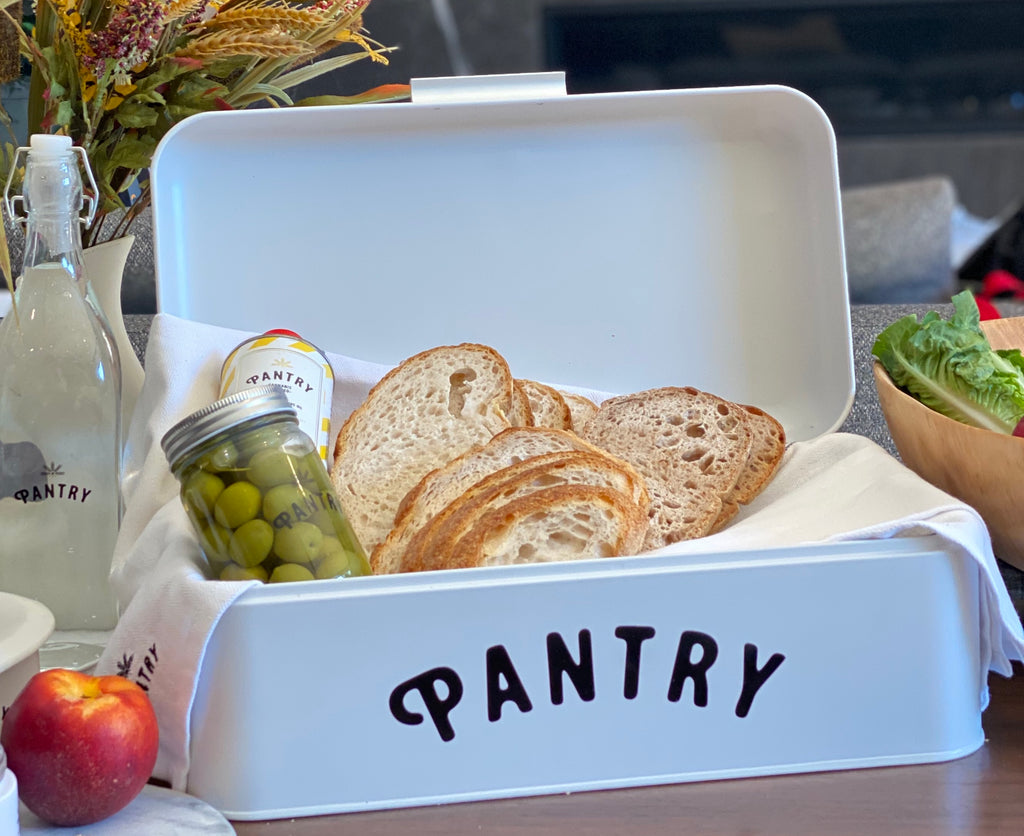 Pantry Bread Basket with Olives Marinating in Jar