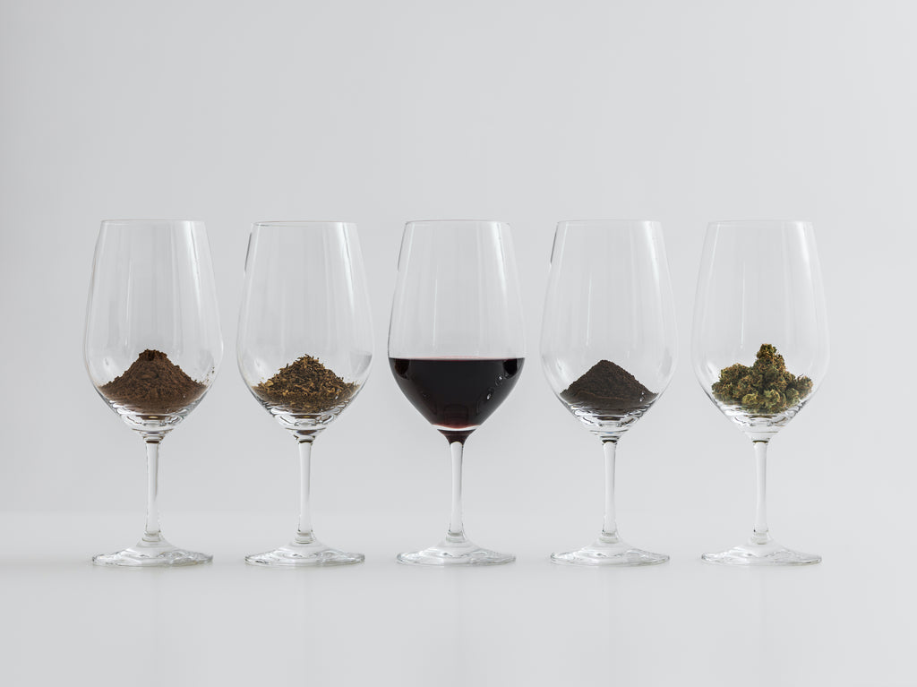 cocoa, chocolate and weed flower displayed in glasses