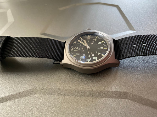 MWC Titanium General Service Watch with 300m Water Resistance, 10 Year Battery Life, GTLS, Sapphire Crystal and 12/24 Dial Format - Needs Secondhand Resetting but Runs Fine