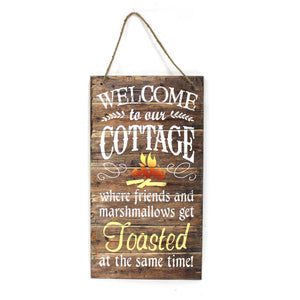 "SIGN ""WELCOME TO OUR COTTAGE WHERE FRIENDS & MARSHMELLOWS GET TOASTED AT THE SAME TIME"" 13X24"""