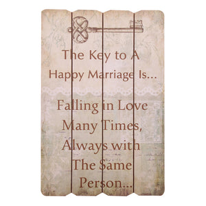 "SIGN "" THE KEY TO A HAPPY MARRIAGE IS FALLING IN LOVE MANY TIMES WITH THE SAME PERSON"" 24X16"