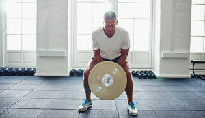 Mature man lifting weights