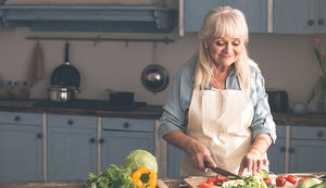 Mature woman preparing fresh food